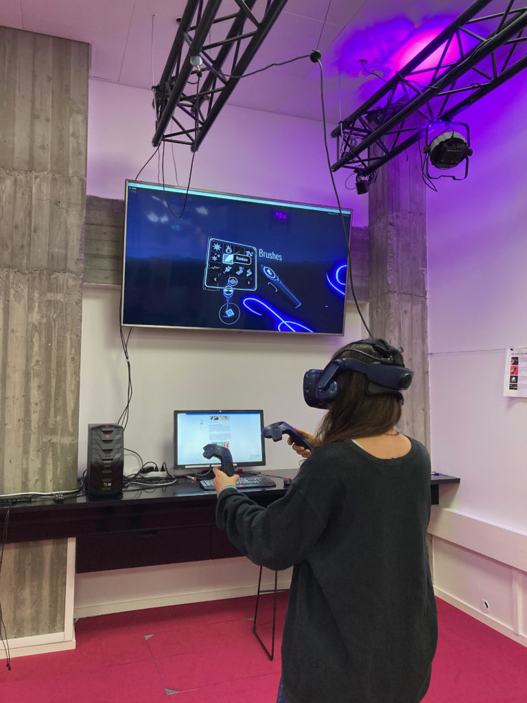 A student with a VR headset and controllers