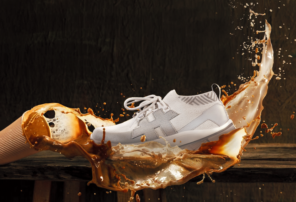 Shoe with Rens logo splashed with coffee